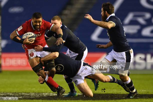 Taulupe Faletau of Wales is tackled during the Guinness Six Nations match between Scotland and Wales at Murrayfield on February 13, 2021 in...
