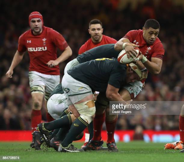 Taulupe Faletau of Wales is tackled during the rugby union international match between Wales and South Africa at the Principality Stadium on December...