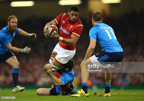 Taulupe Faletau of Wales is wrapped up by the Italy defence during the RBS Six Nations match between Wales and Italy at the Principality Stadium on...