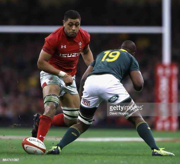 Taulupe Faletau of Wales kicks the ball past Oupa Mohoje during the rugby union international match between Wales and South Africa at the...
