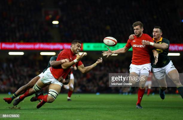 Taulupe Faletau of Wales offloads the ball to Hadleigh Parkes of Wales who later goes onto score a try during the international match match between...