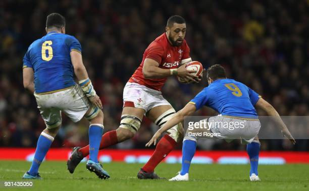 Taulupe Faletau of Wales takes on Marcelo Violi during the NatWest Six Nations match between Wales and Italy at the Principality Stadium on March 11...