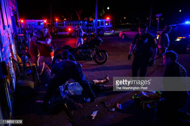 Taunton Police officers and paramedics respond to the scene of an apparent overdose outside of a bar on Monday June 24 in Taunton MA The young man...
