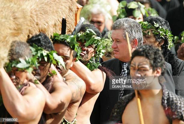 Maori King Tuheitia Paki looks at the featherdraped coffin of his mother Queen Te Arikinui Dame Te Atairangikaahu as Maori Warriors carry to her...