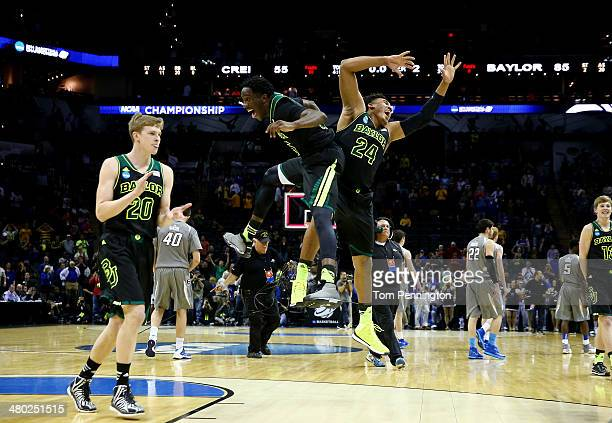 Taurean Prince and Ish Wainright of the Baylor Bears celebrate after defeating the Creighton Bluejays 8555 in the third round of the 2014 NCAA Men's...