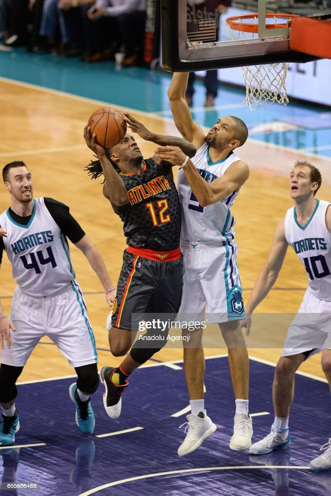 Taurean Prince (12) of Atlanta Hawks in action during the NBA match between Charlotte Hornets vs Atlanta Hawks at the Spectrum arena in Charlotte, United States on March 20, 2017.
