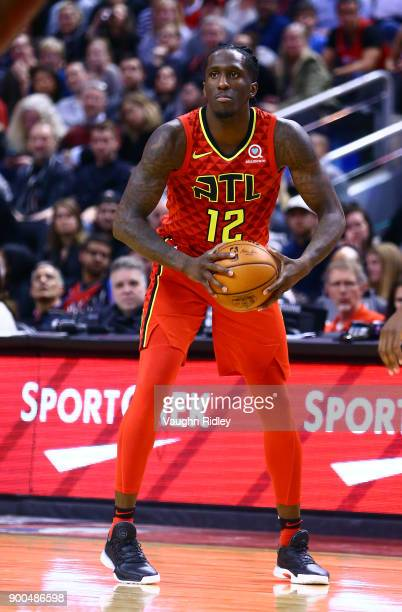 Taurean Prince of the Atlanta Hawks dribbles the ball during the second half of an NBA game against the Toronto Raptors at Air Canada Centre on...