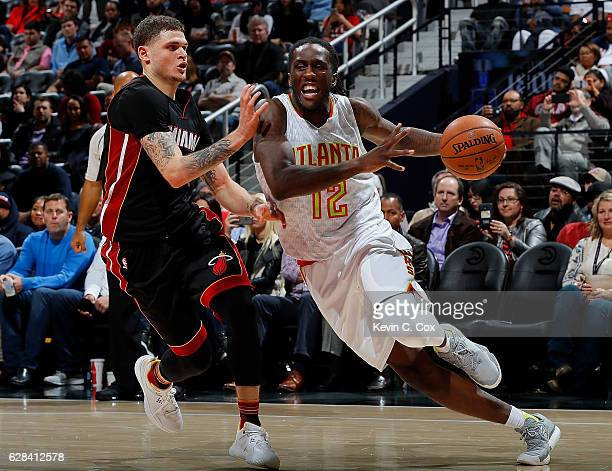 Taurean Prince of the Atlanta Hawks drives against Tyler Johnson of the Miami Heat at Philips Arena on December 7 2016 in Atlanta Georgia NOTE TO...