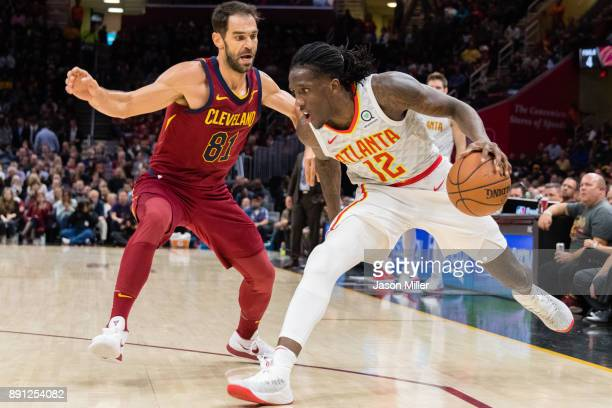 Taurean Prince of the Atlanta Hawks drives past Jose Calderon of the Cleveland Cavaliers during the second half at Quicken Loans Arena on December 12...