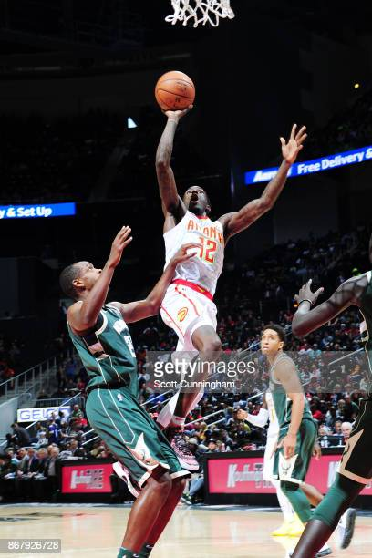 Taurean Prince of the Atlanta Hawks drives to the basket against the Milwaukee Bucks on October 29 2017 at Philips Arena in Atlanta Georgia NOTE TO...
