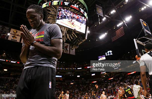 Taurean Prince of the Atlanta Hawks gestures while teammate Dennis Schroder shooting makes a freethrow during the final seconds of the game against...