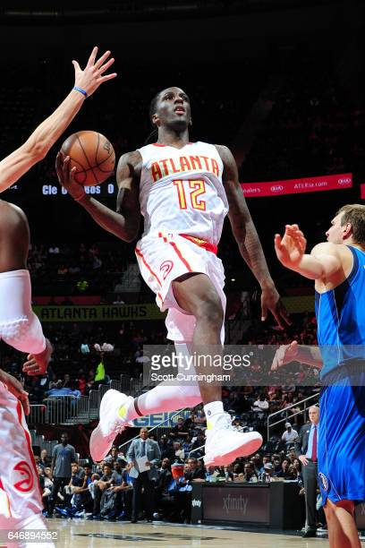 Taurean Prince of the Atlanta Hawks goes to the basket against the Dallas Mavericks on March 1 2017 at Philips Arena in Atlanta Georgia NOTE TO USER...