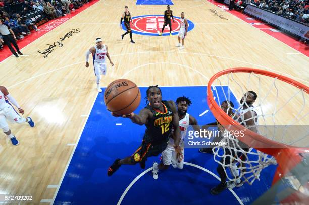Taurean Prince of the Atlanta Hawks goes to the basket against the Detroit Pistons on November 10 2017 at Little Caesars Arena in Auburn Hills...