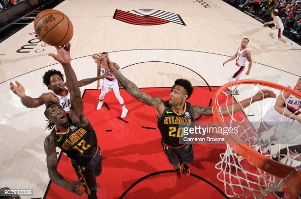 Taurean Prince of the Atlanta Hawks goes up for a rebound against the Portland Trail Blazers on January 5 2018 at the Moda Center Arena in Portland...
