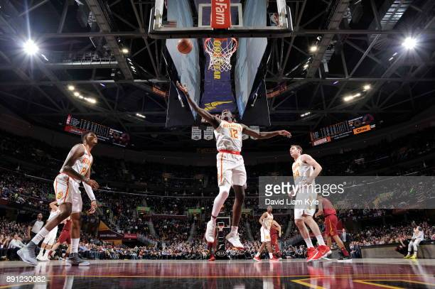Taurean Prince of the Atlanta Hawks grabs the rebound against the Cleveland Cavaliers on December 12 2017 at Quicken Loans Arena in Cleveland Ohio...