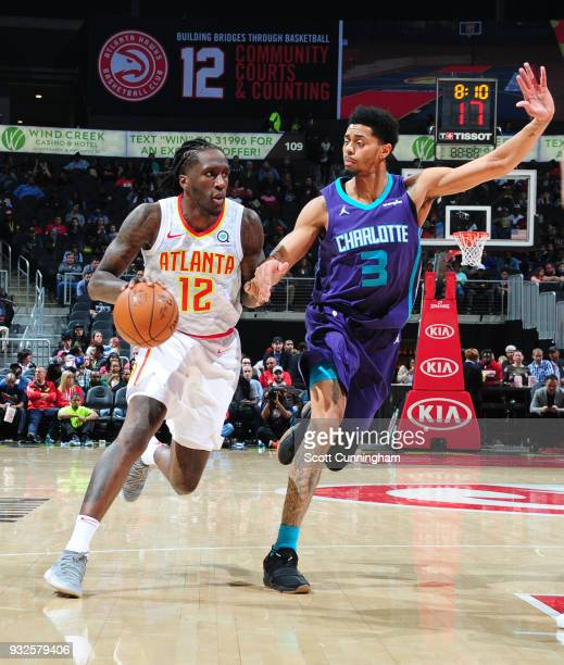 Taurean Prince of the Atlanta Hawks handles the ball against Jeremy Lamb of the Charlotte Hornets on March 15 2018 at Philips Arena in Atlanta...