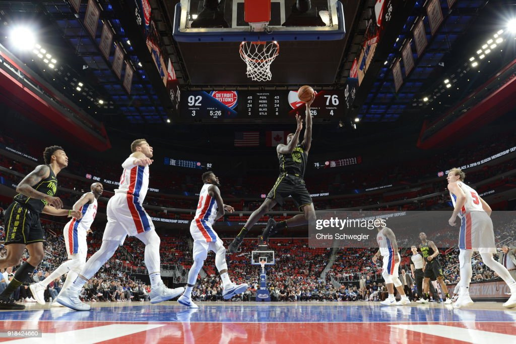 Taurean Prince #12 of the Atlanta Hawks handles the ball against the Detroit Pistons on February 14, 2018 at Little Caesars Arena in Detroit, Michigan.