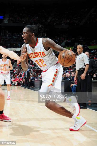 Taurean Prince of the Atlanta Hawks handles the ball against the Washington Wizards during Game Six of the Eastern Conference Quarterfinals of the...