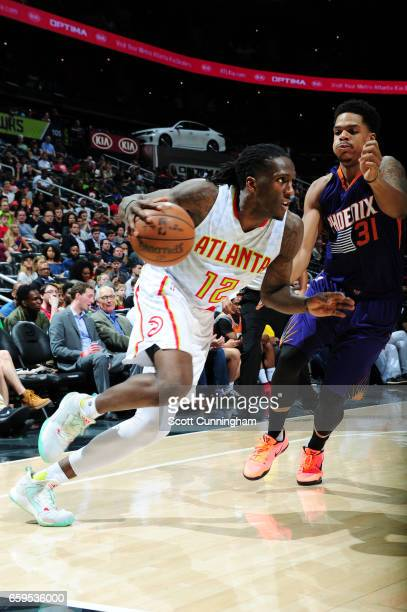 Taurean Prince of the Atlanta Hawks handles the ball during a game against the Phoenix Suns on March 28 2017 at Philips Arena in Atlanta Georgia NOTE...