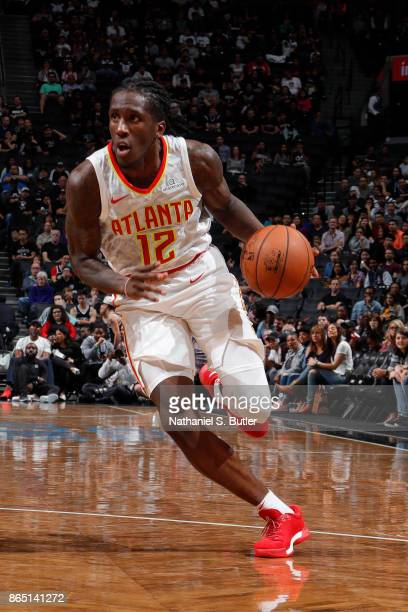 Taurean Prince of the Atlanta Hawks handles the ball during the game against the Brooklyn Nets on October 22 2017 at Barclays Center in Brooklyn New...