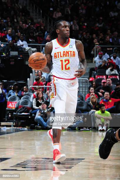 Taurean Prince of the Atlanta Hawks handles the ball during the game against the Portland Trail Blazers on December 30 2017 at Philips Arena in...