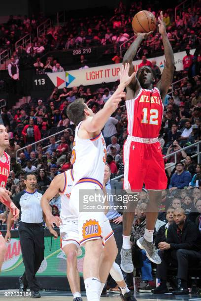 Taurean Prince of the Atlanta Hawks hits the game winning shot against the Phoenix Suns on March 4 2018 at Philips Arena in Atlanta Georgia NOTE TO...