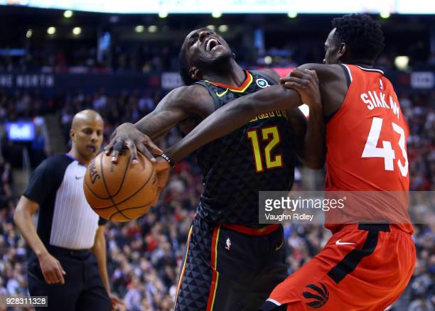Taurean Prince of the Atlanta Hawks is fouled by Pascal Siakam of the Toronto Raptors during the second half of an NBA game at Air Canada Centre on...
