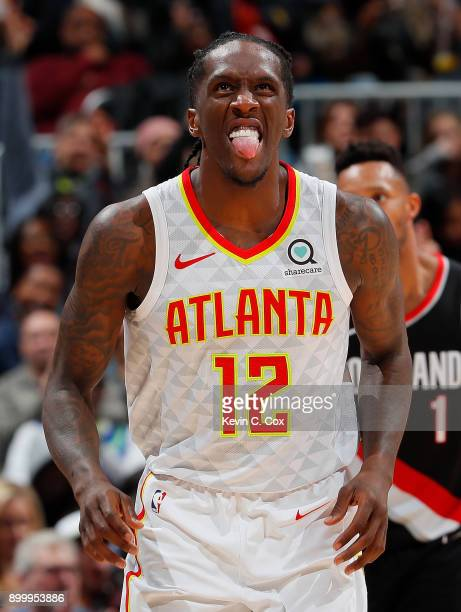 Taurean Prince of the Atlanta Hawks reacts after hitting a threepoint basket against the Portland Trail Blazers at Philips Arena on December 30 2017...