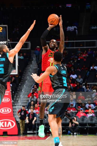 Taurean Prince of the Atlanta Hawks shoots the ball against the Charlotte Hornets on November 25 2018 at State Farm Arena in Atlanta Georgia NOTE TO...