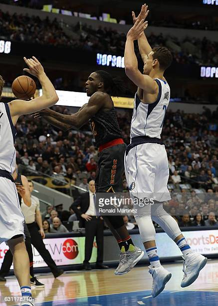 Taurean Prince of the Atlanta Hawks takes a shot against Dwight Powell of the Dallas Mavericks at American Airlines Center on January 7 2017 in...