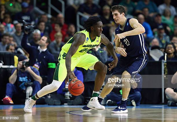Taurean Prince of the Baylor Bears drives against Nick Victor of the Yale Bulldogs in the first half of their game during the first round of the 2016...