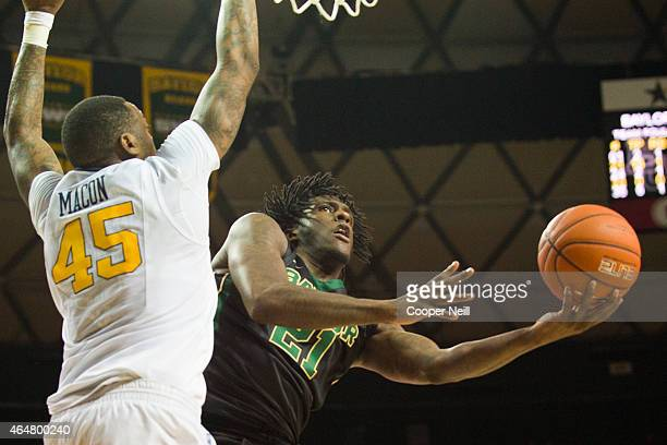 Taurean Prince of the Baylor Bears drives to the basket against Elijah Macon of the West Virginia Mountaineers on February 28, 2015 at the Ferrell...
