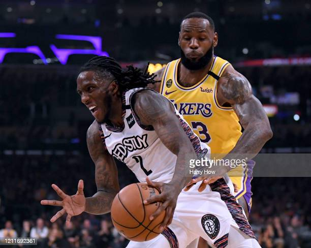 Taurean Prince of the Brooklyn Nets dribbles past LeBron James of the Los Angeles Lakers during the first half at Staples Center on March 10 2020 in...