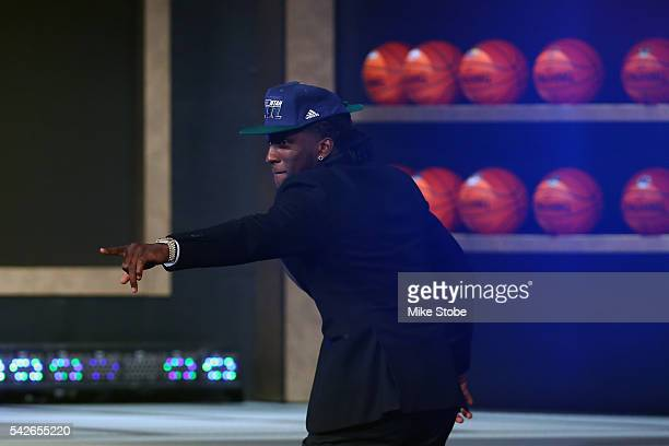 Taurean Prince walks ons stage after being drafted 12th overall by the Utah Jazz in the first round of the 2016 NBA Draft at the Barclays Center on...