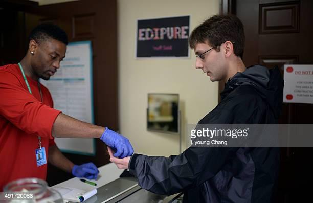 Taurean Wilson of Botana Care left helps Kevin Murphy of Arvada purchasing recreational marijuana Northglenn Colorado May 16 2014