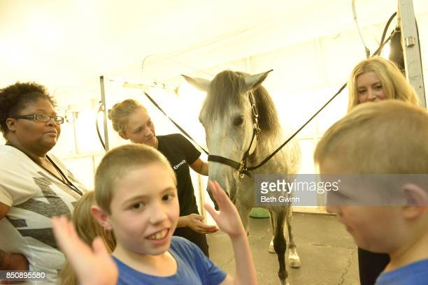 Taurus Bush and Levi Dykes truns away from the horse to the camera on September 21 2017 in Nashville Tennessee