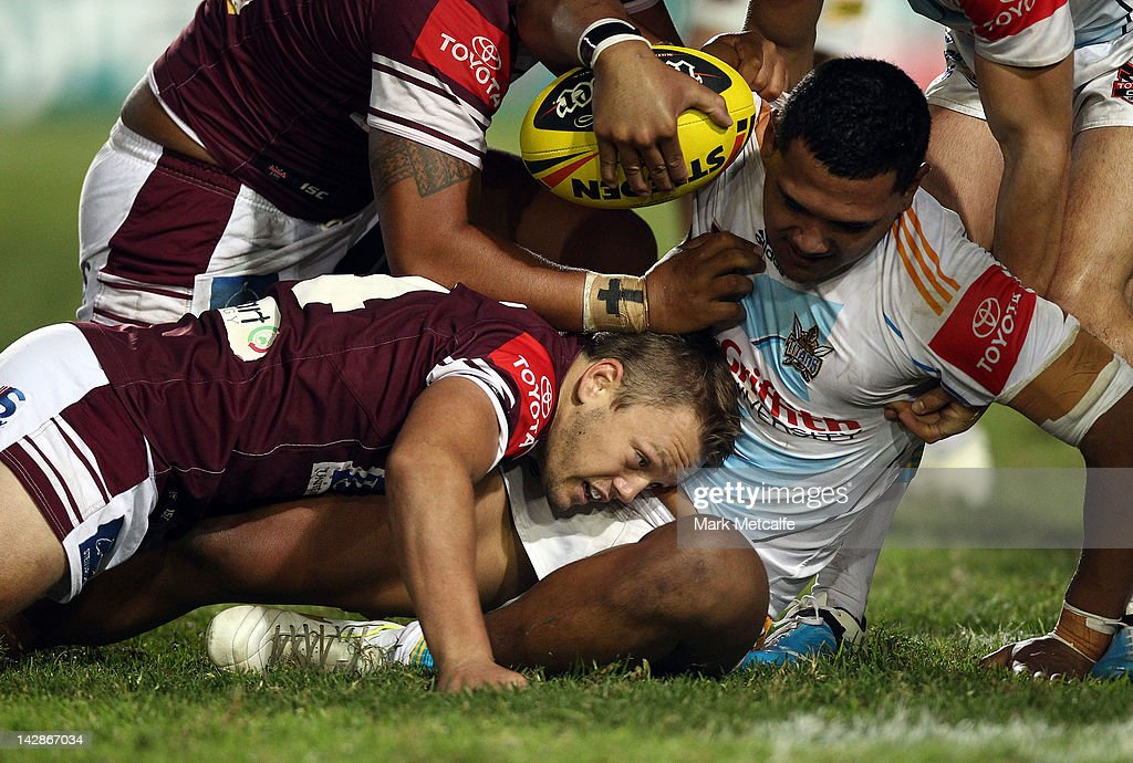 Tauryn Laurenson of the Titens is tackled by Pat Murphy of the Sea Eagles during the round seven Toyota Cup match between the Manly Sea Eagles and the Gold Coast Titans at Brookvale Oval on April 14, 2012 in Sydney, Australia.