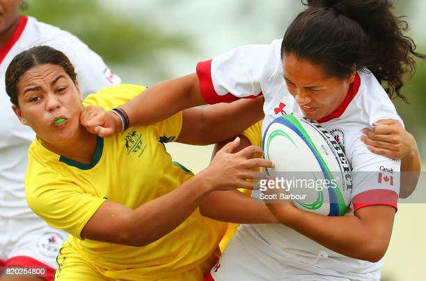 Tausani Levale of Canada is tackled by Kennedy Cherrington of Australia during the Rugby Sevens Girls Gold Medal match between Australia and Canada...