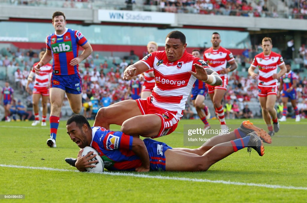 Tauta Moga of the Knights scores as Tyson Frizell of the Dragons attempts to stop him during the round four NRL match between the St George Illawarra Dragons and the Newcastle Knights at WIN Stadium on April 1, 2018 in Wollongong, Australia.