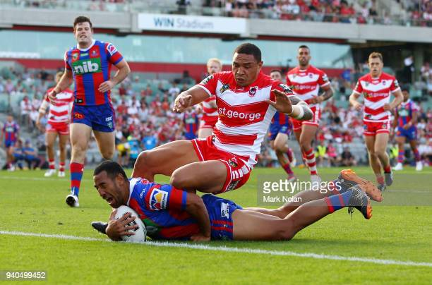 Tauta Moga of the Knights scores as Tyson Frizell of the Dragons attempts to stop him during the round four NRL match between the St George Illawarra...