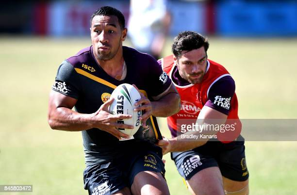 Tautau Moga attempts to break away from the defence during a Brisbane Broncos NRL training session on September 12 2017 in Brisbane Australia