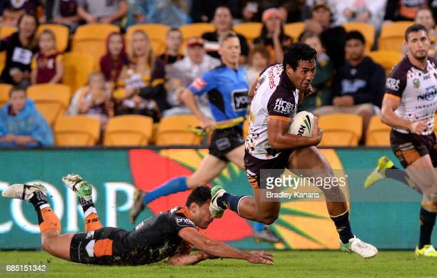 Tautau Moga of the Broncos breaks away from the defence before going on to score a try during the round 11 NRL match between the Brisbane Broncos and...