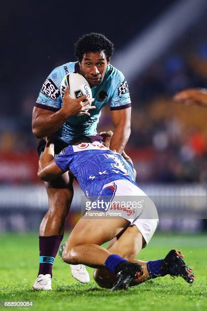 Tautau Moga of the Broncos charges forward during the round 12 NRL match between the New Zealand Warriors and the Brisbane Broncos at Mt Smart...