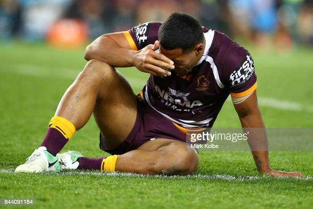 Tautau Moga of the Broncos holds his head after tackle during the NRL Qualifying Final match between the Sydney Roosters and the Brisbane Broncos at...