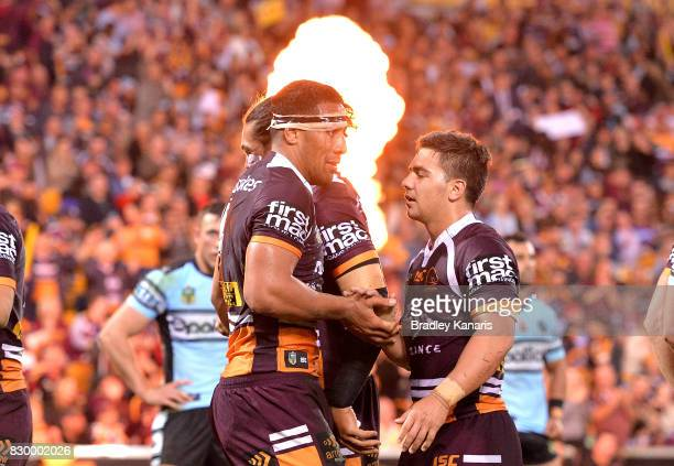 Tautau Moga of the Broncos is congratulated by team mates after scoring a try during the round 23 NRL match between the Brisbane Broncos and the...
