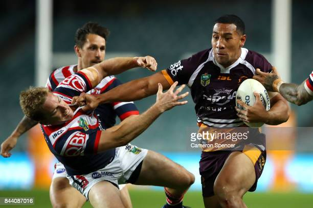 Tautau Moga of the Broncos is tackled during the NRL Qualifying Final match between the Sydney Roosters and the Brisbane Broncos at Allianz Stadium...