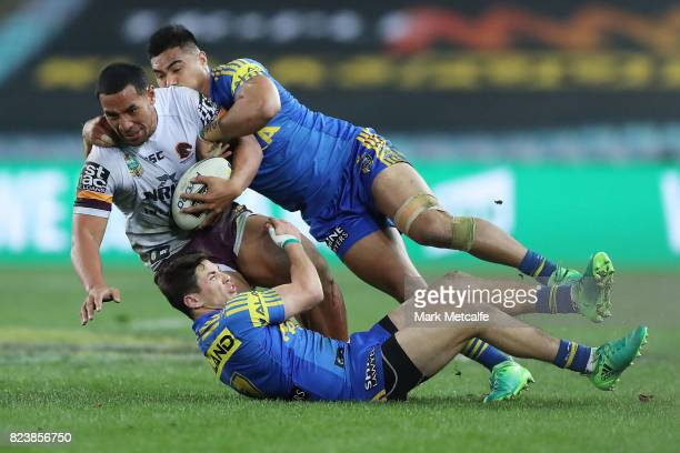 Tautau Moga of the Broncos is tackled during the round 21 NRL match between the Parramatta Eels and the Brisbane Broncos at ANZ Stadium on July 28...
