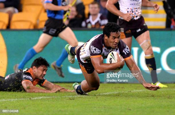 Tautau Moga of the Broncos scores a try during the round 11 NRL match between the Brisbane Broncos and the Wests Tigers at Suncorp Stadium on May 19...
