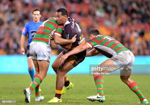 Tautau Moga of the Broncos takes on the defence during the round 14 NRL match between the Brisbane Broncos and the South Sydney Rabbitohs at Suncorp...