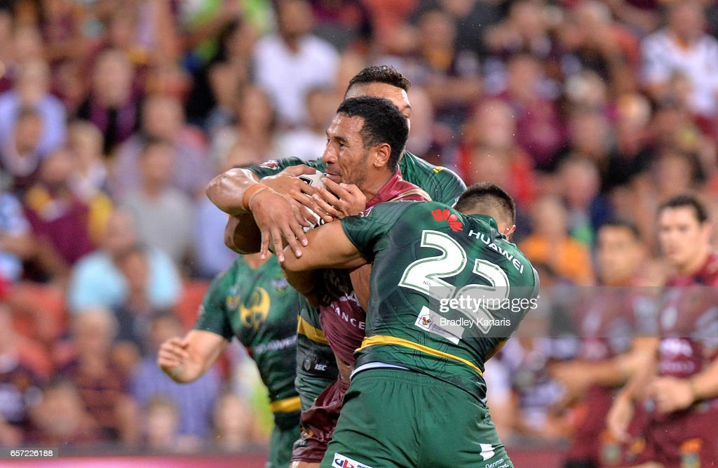 Tautau Moga of the Broncos takes on the defence during the round four NRL match between the Brisbane Broncos and the Canberra Raiders at Suncorp Stadium on March 24, 2017 in Brisbane, Australia.